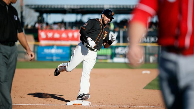 San Francisco Giants first baseman Chris Marrero (49) rounds third on his way home after hitting a 3-run walk off home run in the bottom of the ninth inning of the MLB Spring Training game between the San Francisco Giants and the Cincinnati Reds at Scottsdale Stadium in Scottsdale, Ariz., on Friday, Feb. 24, 2017. The Reds fell to the Giants, 6-4.