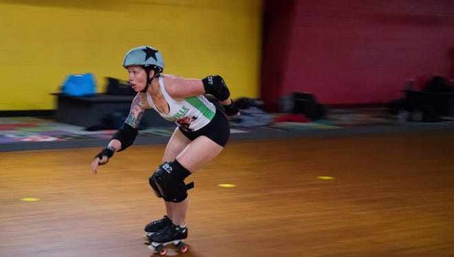 "Eden Rogers, also known as ""Reload"" skates during roller derby practice at Skateland USA on Wednesday, March 28, 2018."