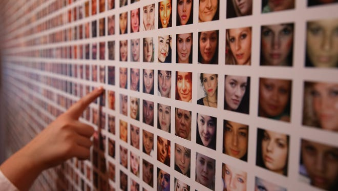 LONDON, ENGLAND - DECEMBER 02:  Some of the photographs of a million users of Facebook collated by artists Paolo Cirio and Alessandro Ludovico are displayed at the Big Bang Data exhibition at Somerset House on December 2, 2015 in London, England. The show highlights the data explosion that's radically transforming our lives. It opens on December 3, 2015 and runs until February 28, 2016 at Somerset House.  (Photo by Peter Macdiarmid/Getty Images for Somerset House)