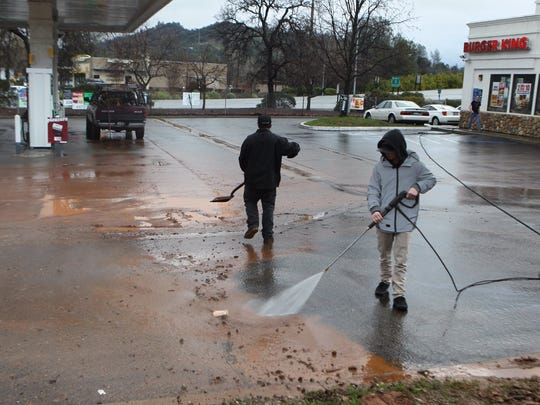 Workers clean up after flooding hit a Burger King and