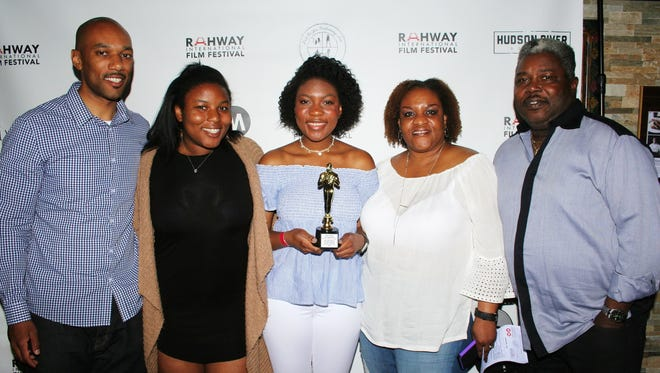 "Alexia Ross (center) with her family at the Big Dreams & Silver Screens Youth Festival in Rahway. She won Best Documentary for her short film, ""You Are What You Wear."""