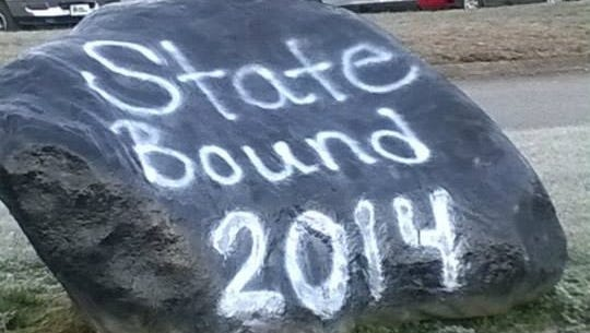A rock painted in front of Robbinsville for the Black Knights football team.