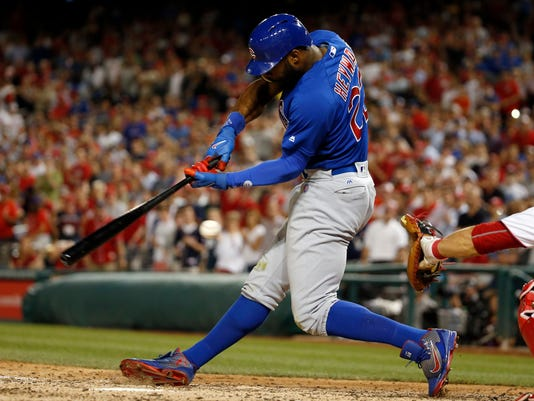 Chicago Cubs' Jason Heyward swings at a pitch, for the third strike and final out in the team's baseball game against the Washington Nationals at Nationals Park, Monday, June 13, 2016, in Washington. The Nationals won 4-1. (AP Photo/Alex Brandon)