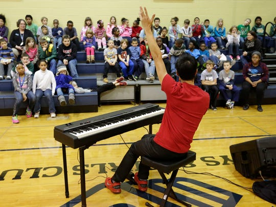 Alpin Hong entertained the students at the Boys and Girls Club in Oshkosh January 7, 2016.  Hong, gave a motivational talk, educated the students and performed for the students at the Club.  He will be performing at the Grand Opera House at 7:30 p.m. on January 9, 2016.  Alpin Hong has been to Oshkosh and the Grand several times.