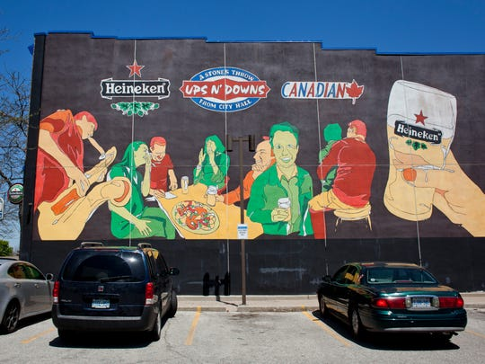 A mural is seen on the side of Ups N' Downs, 226 North Front Street in Sarnia.