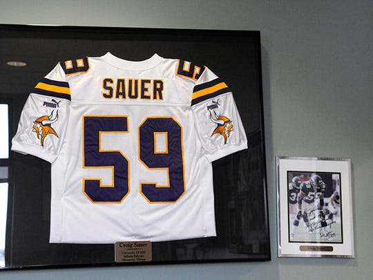 A jersey and photograph from Craig Sauer's NFL career