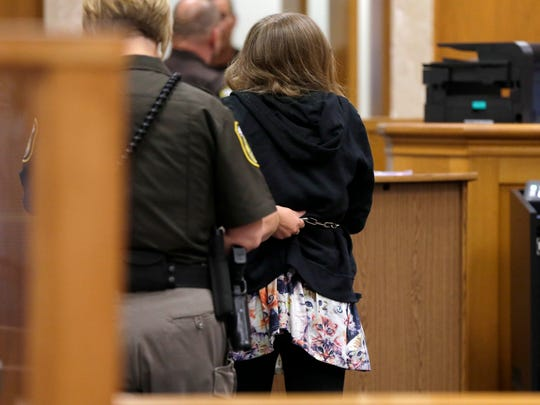 One of the two girls accused of stabbing a classmate leaves a Waukesha County courtroom in Waukesha on Monday, Aug. 10, 2015. The judge ruled that the two girls will stay in adult court, where they could face decades in prison.