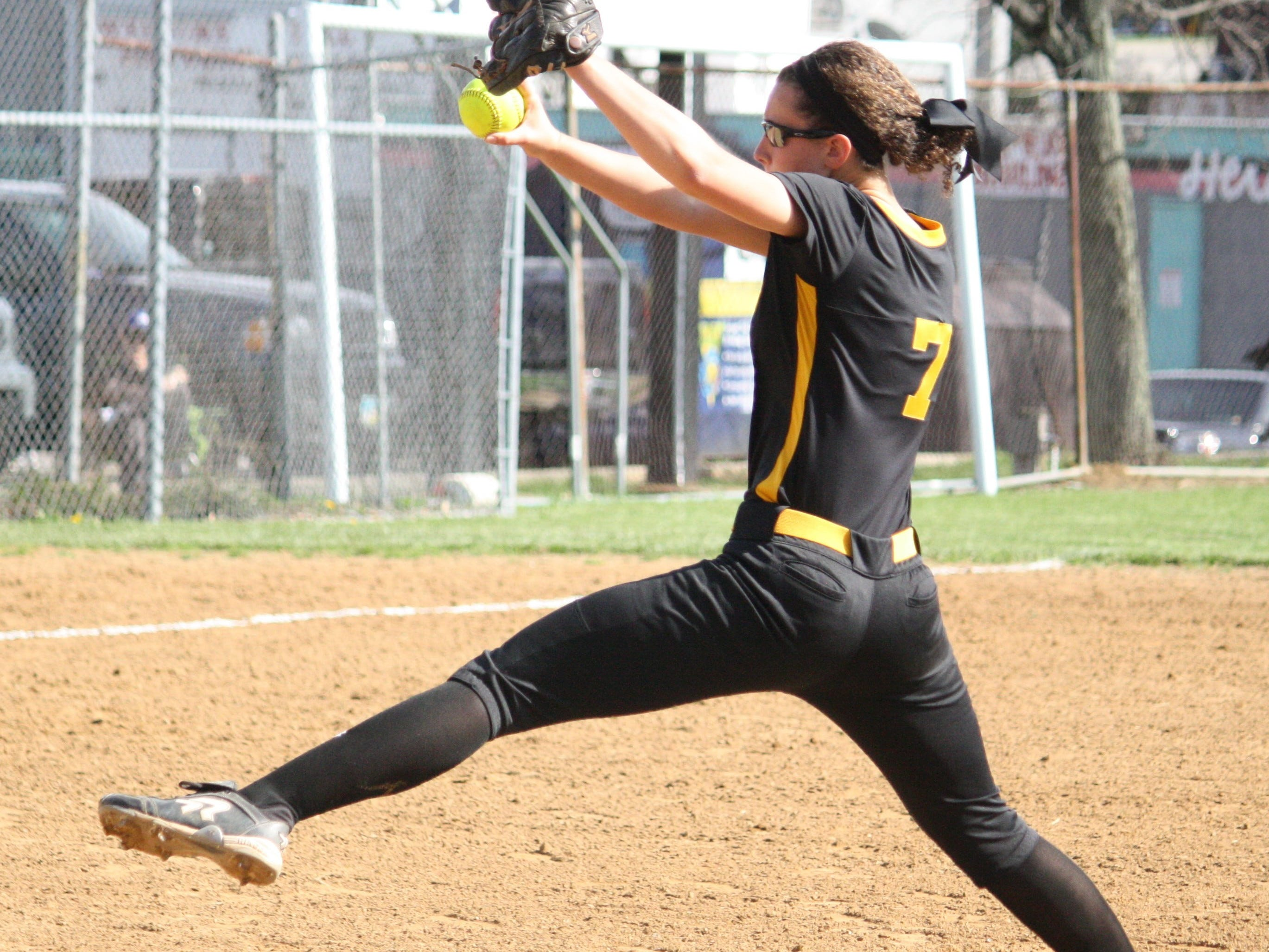 McAuley High School junior pitcher Aubrey Brunst delivers to home plate against Mercy on April 17.