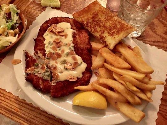 """Tender calamari steak pan fried in """"secret sauce."""""""