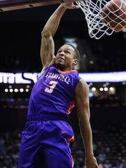 Evansville's Jaylon Brown dunks the ball against Missouri