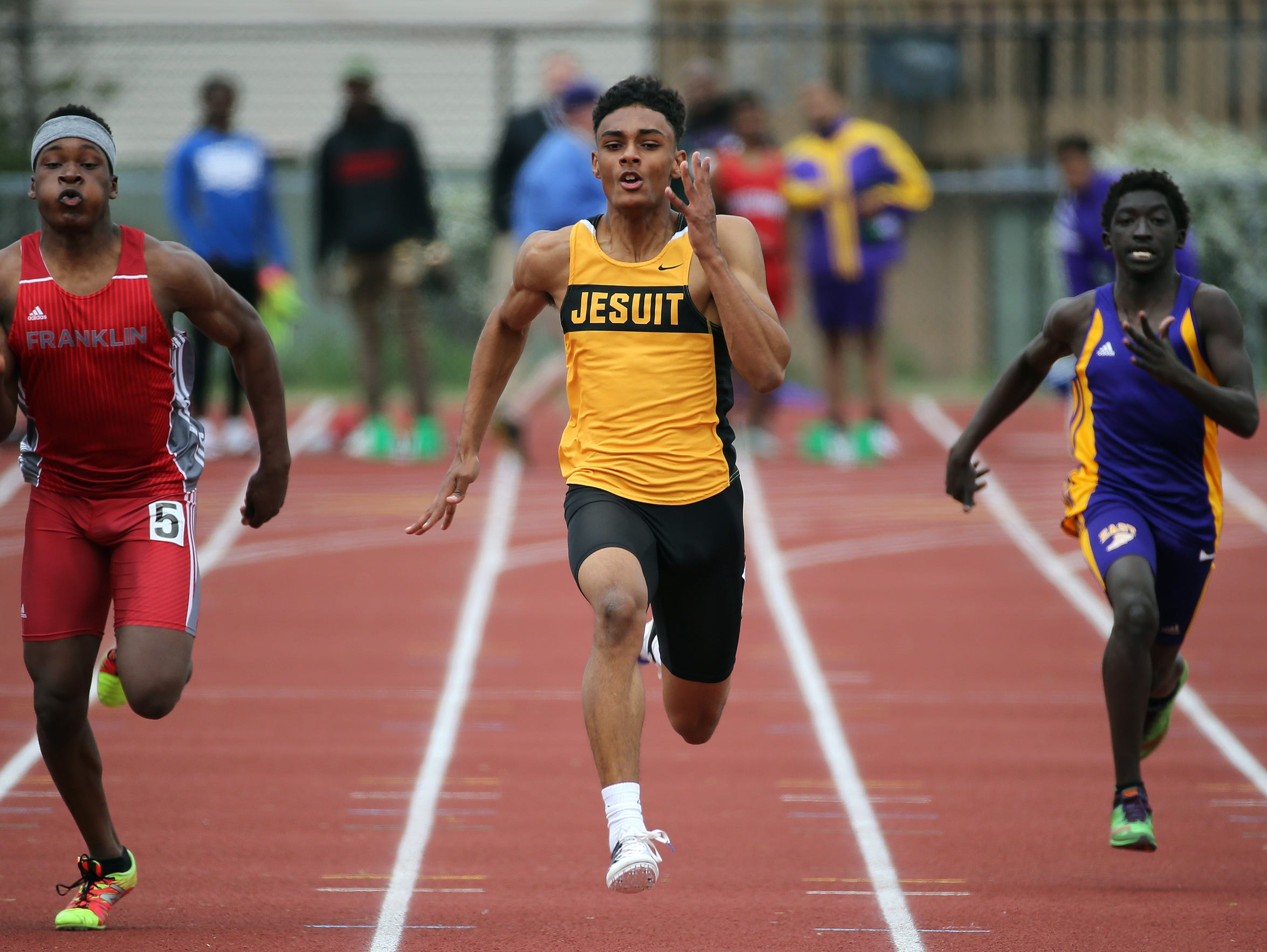 McQuaid's Noah Williams wins the 100 dash with a time