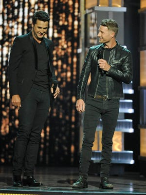 Academy of Country Music Awards co-hosts Luke Bryan, left, and Dierks Bentley during the 52nd Academy of Country Music Awards at T-Mobile Arena on Sunday, April 2, 2017, in Las Vegas, Nev.