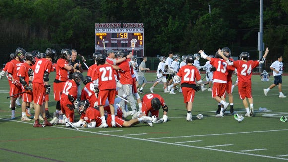 Somers launches into celebration mode after Cameron Pepe scored in overtime to give the Tuskers a 10-9 win over Harrison on May 21, 2018.