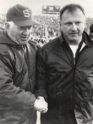 Michigan coach Bo Schembechler, right little to smile
