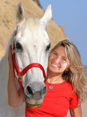 Lisa Brisse with her horse of more than 30 years, Little Miss.