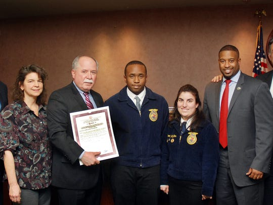Union County Freeholder Chairman Mohamed Jalloh (second from right) and Freeholders Bruce Bergen (left) and Alexander Mirabella (right) present a resolution to Union County Vocational-Technical Schools Superintendent Peter Capodice, Future Farmers of America (FFA) advisor and horticulture instructor Bonnie Baldasare, FFA member Aaron Etnine and FFA president Margaret Hopkins designating the last week of February as Future Farmers of America Week in Union County.
