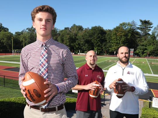 The Robertson brothers have all played football for Iona Prep in New Rochelle. Here they are pictured at the school Sept. 15, 2017, from left, Derek Robertson, 16, Dennis Robertson, 32, and Jimmy Robertson, 30.