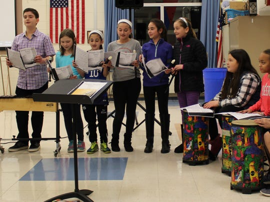 ALT fifth graders Dominic Popolo, John Williams, Adeline Rees, Isabella Valenti, Gabriella Pento, Alexandra Demola, Kayley Moran, Gianna Rodden, Julia de Montagnac, and Briana DiNardi entertain board members with a brief musical