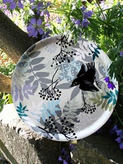 This birch tray from Sveinbjorg.is called Garden Party.