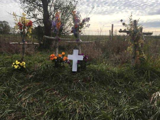Crosses in a farmer's field along I-94 in Dane County