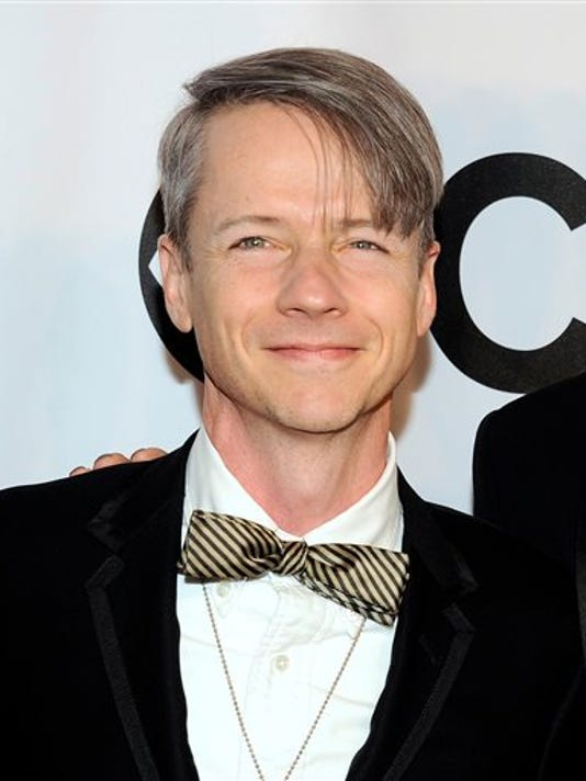 FILe - In this June 8, 2014 file photo, John Cameron Mitchell arrives at the 68th annual Tony Awards in New York.