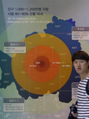 A visitor walks by a display illustrating the damage a 1MT class nuclear weapon would cause if detonated in Seoul, at the Korea War Memorial Museum in Seoul, South Korea, Tuesday, Sept. 15, 2015. A day after threatening long-range rocket launches, North Korea declared Tuesday that it has upgraded and restarted all its atomic fuel plants so it can produce more - and more sophisticated - nuclear weapons. (AP Photo/Ahn Young-joon)