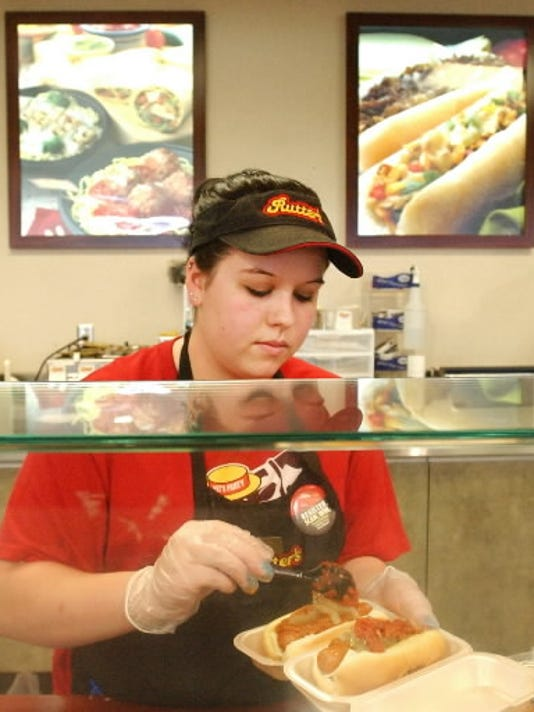 Ashley Meyers prepares an order at Rutter s Farm Store in Manchester Township. Rutter s started expanding its food service in 2007, offering items such as stir-fried selections and pasta bowls.
