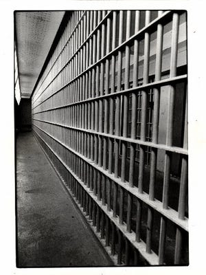 Is the Department of Corrections reducing the security classifications of prisoners as a cost-saving measure?