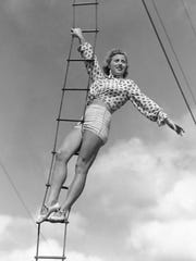"In this Feb. 28, 1945 photo, Elizabeth Wallenda pauses on an aerial ladder during rehearsal for her return to the Wallenda troupe's high wire act with the Ringling Brothers and Barnum and Bailey Circus, now in winter quarters in Sarasota, Fla. The Ringling Bros. and Barnum & Bailey Circus will end ""The Greatest Show on Earth"" in May 2017, following a 146-year run of performances. Kenneth Feld, the chairman and CEO of Feld Entertainment, which owns the circus, told The Associated Press when the company removed the elephants from the shows in May of 2016, ticket sales declined more dramatically than expected."