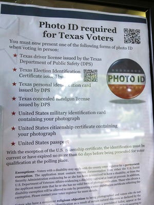 "FILE - In this Nov. 5, 2013 file photo, a sign in a window tells of photo ID requirements for voting at a polling location in Richardson, Texas. A judge has ruled for a second time that Texas' strict voter ID law was intentionally crafted to discriminate against minorities.The ruling by U.S. District Judge Nelva Gonzales Ramos of Corpus Christi Monday, April 10, 2017, comes more than two years after she likened the ballot-box rules in Texas to a ""poll tax"" meant to suppress minority voters."