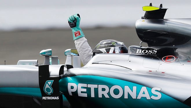 Rosberg celebrates after the qualifier on the Hockenheimring.