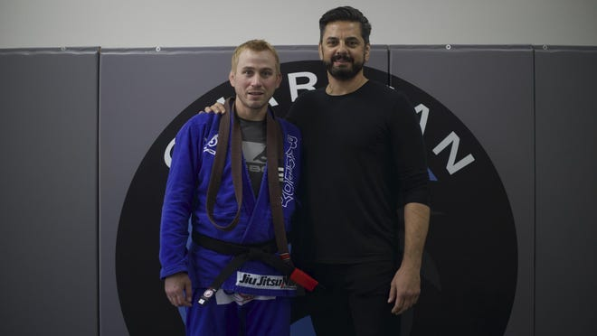 Kevin Irwin (left) and Misho Ceko after Irwin earned his black belt.