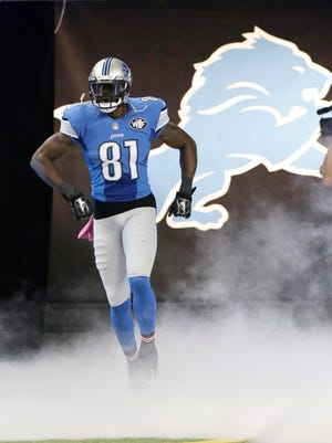 Detroit Lions wide receiver Calvin Johnson is introduced before a game against the Buffalo Bills on Oct. 5, 2014, in Detroit.
