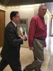 Richard Smith, right, enters Fremont Municipal Court