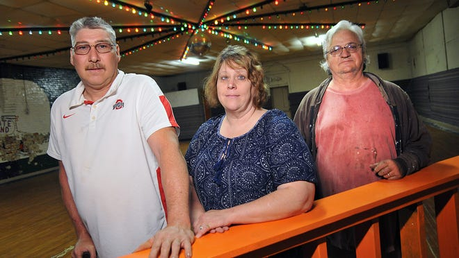 Andy and Tenia Thoroughman, owners of SK8 Factory, along with Steve Witten, pose for a portait at their rink.