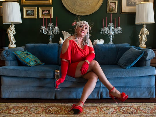 Joyce Bell wears a red knit cold-shoulder dress by