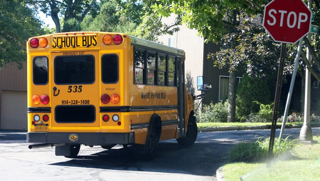 A White Plains School Bus travels along the area of Middale Road in White Plains, Sept. 2, 2016.