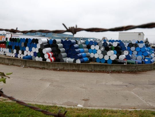 Steel drums are stacked outside of the IndyDrum plant,