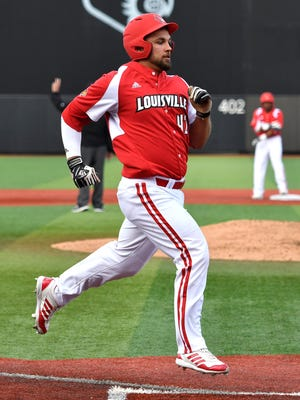 Louisville's  Colby Fitch crooses home to score during their game against Kentucky at Jim Patterson Stadium, Tuesday, April. 4, 2017 in Louisville Ky.