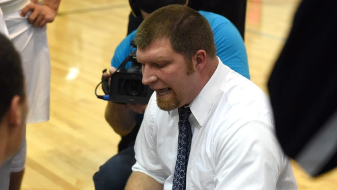 Morgan coach Adam Copeland draws up instruction to his players during a fourth quarter timeout against John Glenn. The Raiders earned the No. 5 seed at the East District tournament drawing.