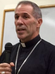 Archbishop Michael Jude Byrnes announces at an Oct. 4, 2017, news conference that the Archdiocese of Agana is closing the last seminary on Guam, the Redemptoris Mater Seminary, by end of 2017. RMS is controlled by the Neocatechumenal Way.