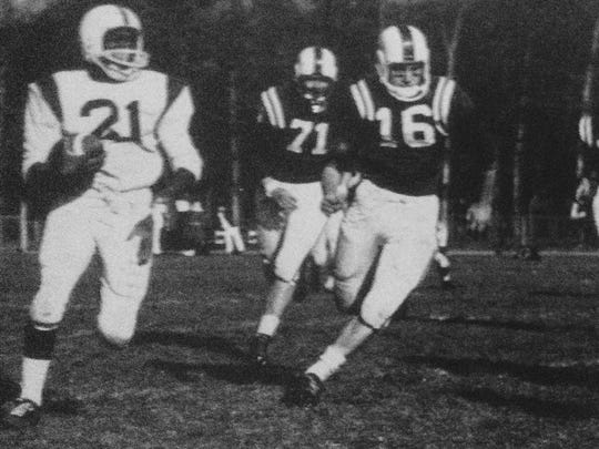Brick defenders chase down a Lakewood running back during the Green Dragons 15-13 win in 1960, part of Brick's first undefeated season.