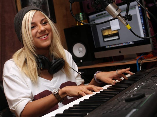 American Idol contestant Jax behind the keyboard in her home recording studio, Monday, February 2, 2015, in East Brunswick, NJ. Jason Towlen/Staff Photographer