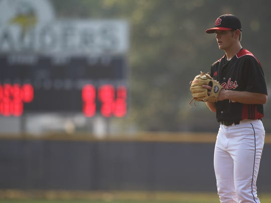 NFC sophomore J.D. Tease prepares to throw a pitch Tuesday against Maclay.