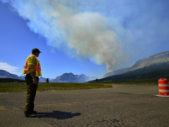 U.S. Park Service Ranger mans the St. Mary entrance to Glacier National Park on Thursday, alerting visiting motorists to the closure of Going-to-the-Sun Road due to the Reynolds Creek fire on Thursday.