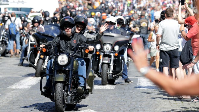 Thousands of Harley-Davidson riders from around the globe take part in a parade through the streets of Prague on Saturday.