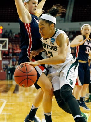 Michigan State forward Aerial Powers (23) tries to dribble past a Belmont defender during the second half in a first-round women's college basketball game in the NCAA Tournament, Friday in Starkville, Miss. Michigan State won 74-60.