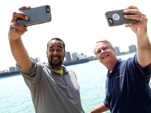 Detroit Free Press photographer Eric Seals and reporter
