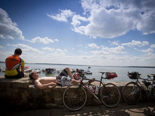 Riders take a break at the water's edge in Clear Lake
