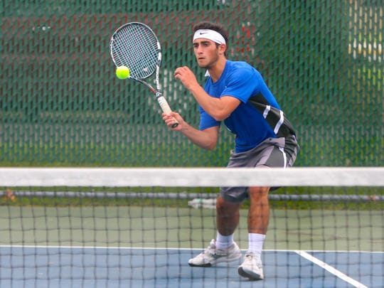 Hammonton's Vince Maimone volleys during a 5-0 setback to Mainland on May 23.